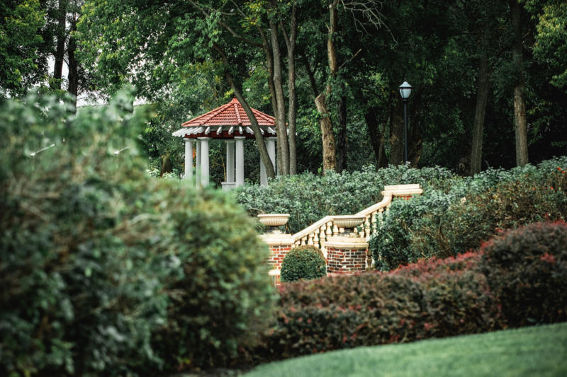 luscious green outdoor shrubbery and gazebo on the property of the longview mansion