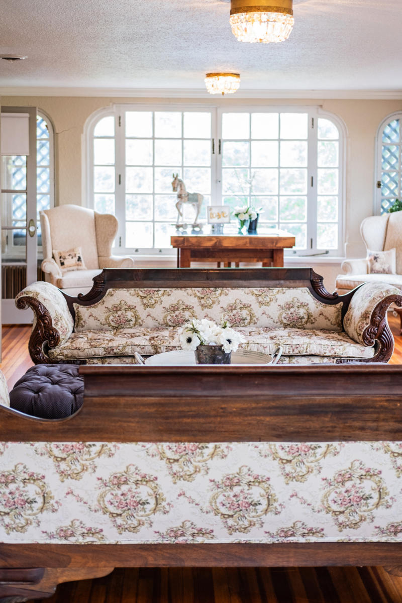 floral couches and large windows inside the completed longview mansion redevelopment project