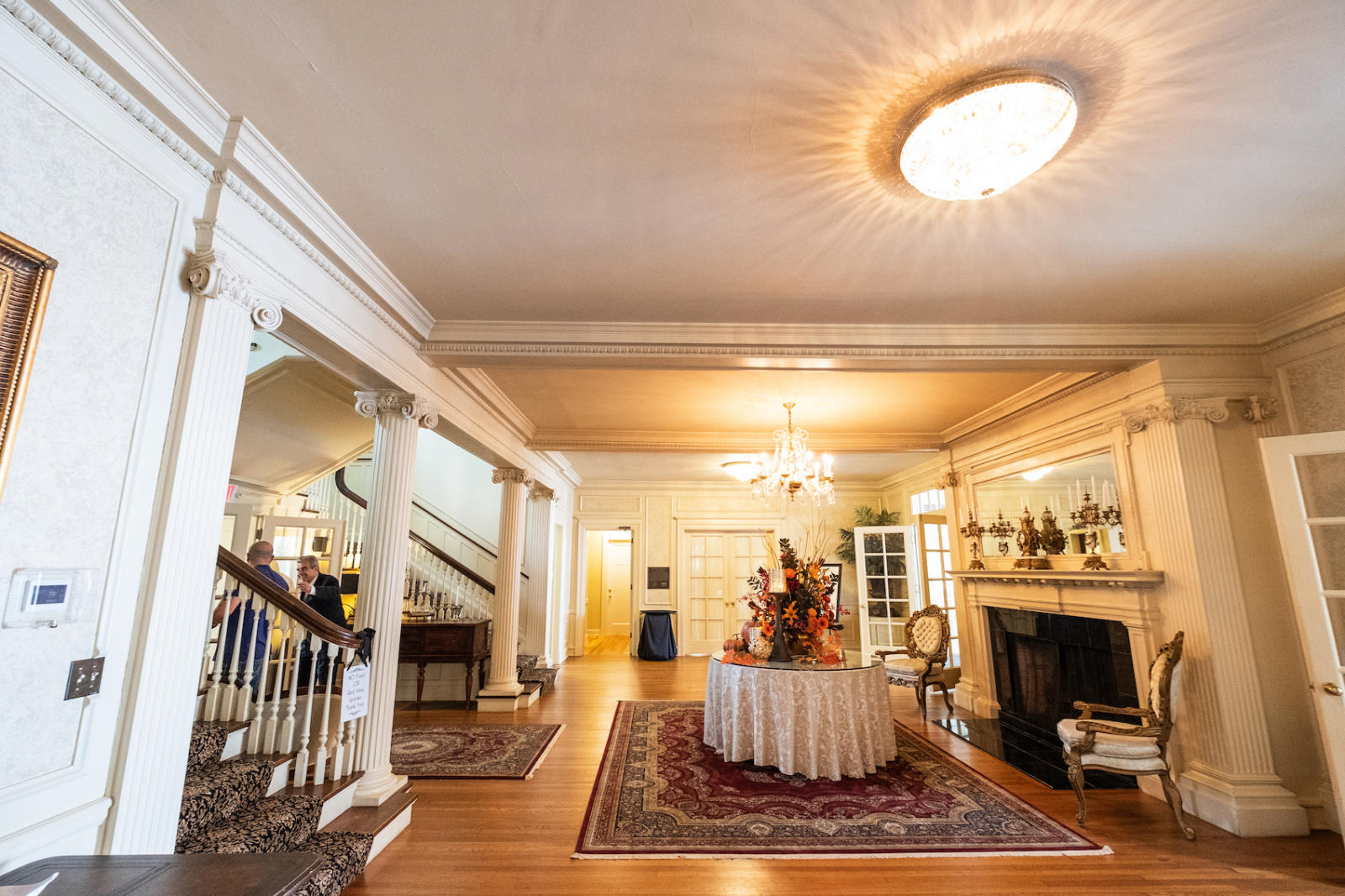 Interior of completed longview mansion historical preservation project's stairway and fireplace